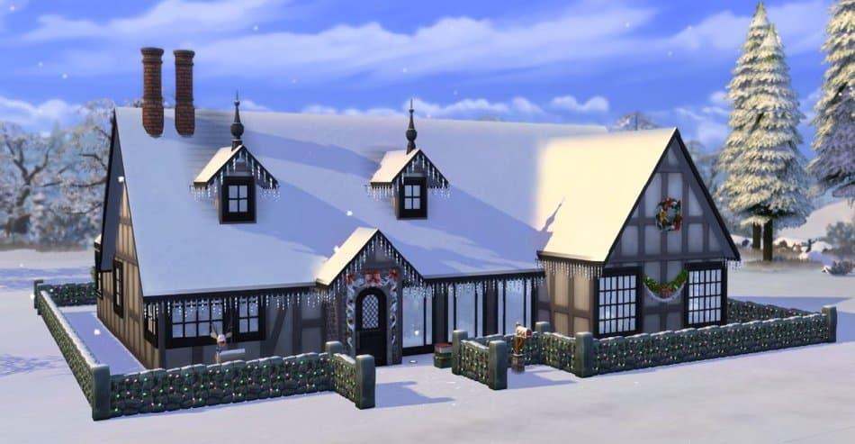 Casa de Los Sims 4 con el tejado cubierto de nieve